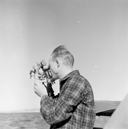 Douglas L. Inman taking bearings on dive sites. for an Offshore Sand Ripple study, 1948 for Fran Shepard. La Jolla Shores,...