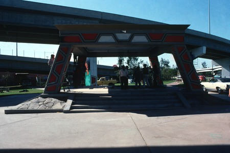 Chicano Park: Kiosko: general view of gazebo with mural artists gathered underneath