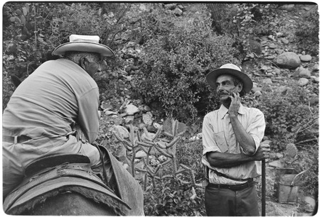 Tacho Arce, left, exchanging gossip with rancher at Rancho San Nicolás