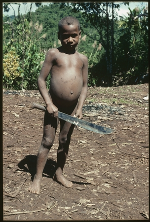 Young boy with bushknife.