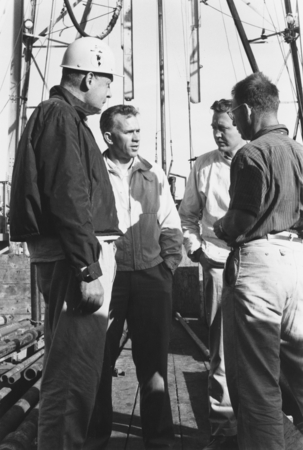 Roger Revelle, Willard Bascom, Gustaf Arrhenius and Walter Munk on CUSS I during preliminary drilling for Project Mohole, ...