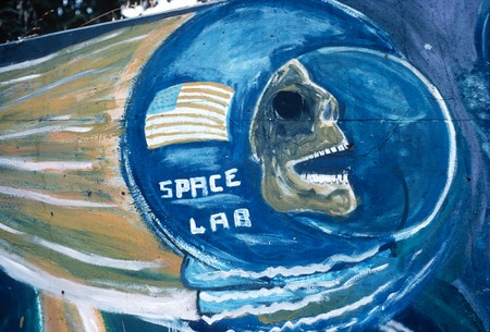 Chicano Park: Historical Mural: detail of skull inside a space helmet