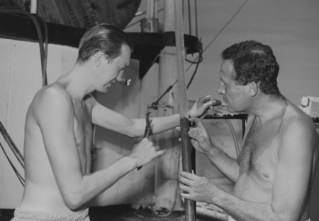 Gustaf Arrhenius (left) and Roger Revelle examine the gravity core which has been detached before the long 28-foot core ba...