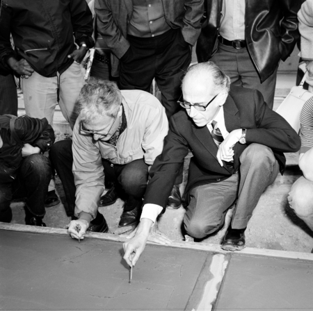 [John Stewart and Jonas Salk writing names in cement, UCSD Muir College, cApril 16, 1971]