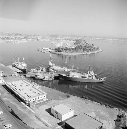 Aerial view of some Scripps Institution of Oceanography ships berthed at the pier of the Chester W. Nimitz Marine Facility...