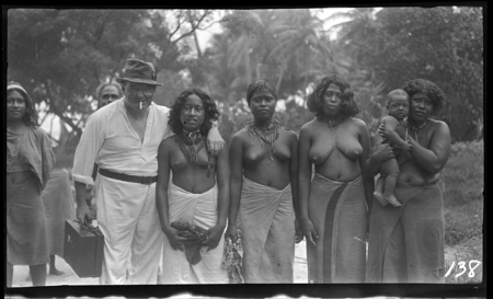 Portrait of several Sikaiana women and infant, with European man.