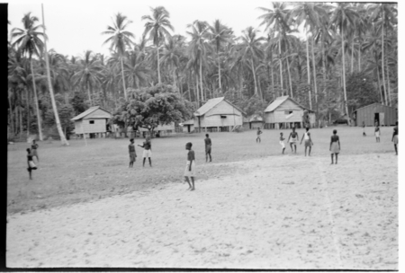 Playing a sport on a village field