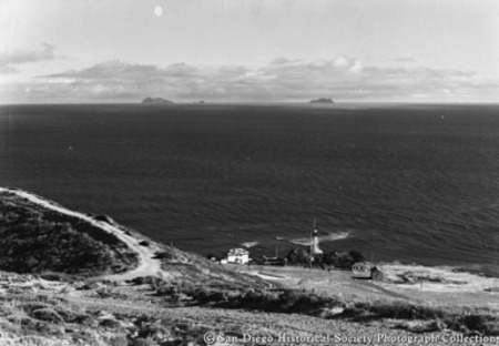 View from Point Loma of lighthouse below and Coronado Islands on horizon