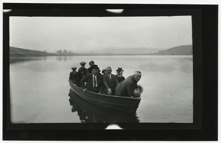 Ed Fletcher and unidentified people in a boat on Lake Hodges