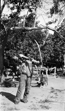 Felipe Jat'am at La Huerta with Cuatro, the dog, demonstrating correct bow and arrow posture