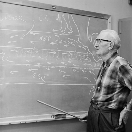 Martin Wiggo Johnson standing in front of blackboard in