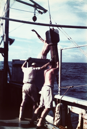 Roger Revelle, James Snodgrass, and Arthur Maxwell on deck of R/V HORIZON recover the temperature gradient recorder that m...