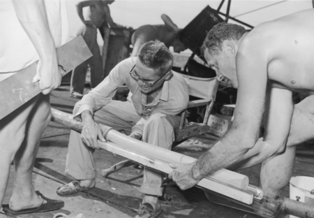 Milton Nunn Bramlette (sitting) and Roger Revelle are shown here with a drill core during the Capricorn Expedition (1952-1...