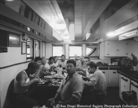 Crew eating in galley of tuna boat