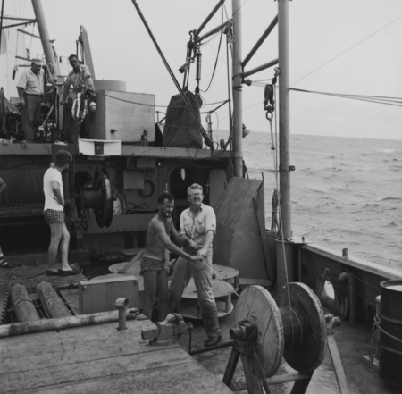Scripps Institution of Oceanography's John Isaacs (right) belaying line into a winch with oceanographic instrumentation of...