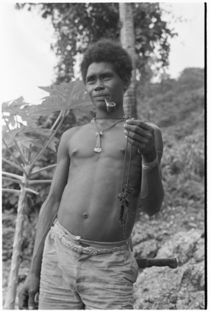 Laete'eboo the priest, holding object that is probably matala ancestral relic he is going to use in the ritual.