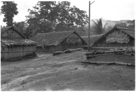 Houses in what appears to be a coastal Christian village, likely not in Kwaio.