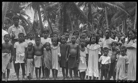 Kiribati children at a hookworm lecture, Fijian presenter on left.