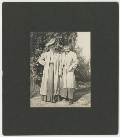 Two  women in coats and hats
