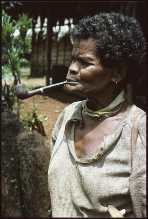 Woman with long pipe.