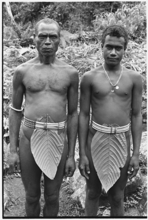 Maenaalamo on left, and Beni Fo'aanamae on right, both of Tofu, wearing fo'osae cane belts.