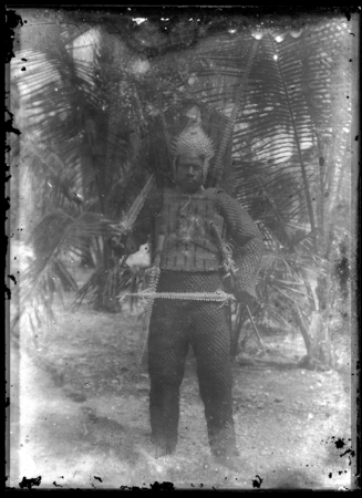 Kiribati man with traditional armour and weapon.