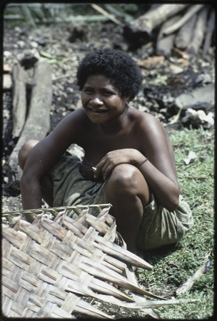 Weaving: Kitemwalusa makes a loosely-woven basket from coconut fronds