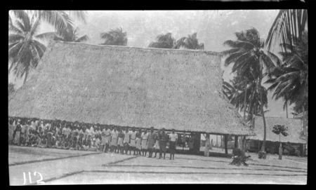 Group of people in front of a meeting house.