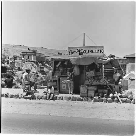 Fruit and soft drink vendors in one of the irregular settlements