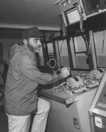 Sid Schulman, D/V Glomar Challenger (ship) crew member, operating the manual controls on the ship's bridge during Leg 57 o...