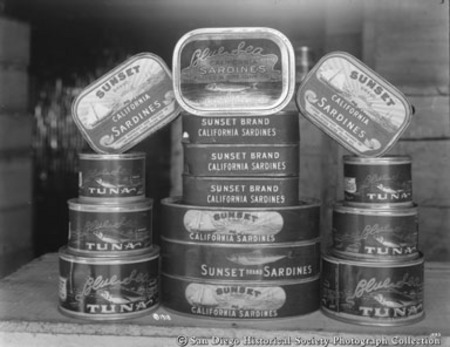Display of canned Sunset brand California sardines and Blue Sea brand tuna from San Pedro Packing Company cannery
