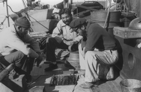 [Men playing chess on deck of R/V E.W. Scripps; Francisco Diaz, center]