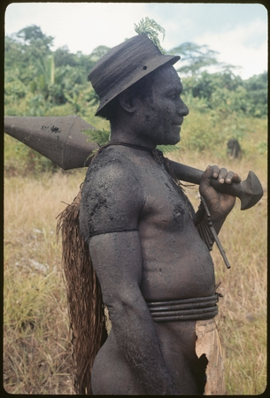 Basiitau painted black, wearing his very old cane hat.