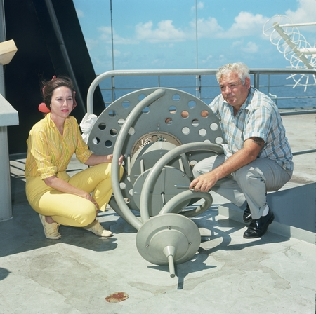 Unidentified man and geologist Betty Gealy aboard the research ship D/V Glomar Challenger during the Deep Sea Drilling Pro...