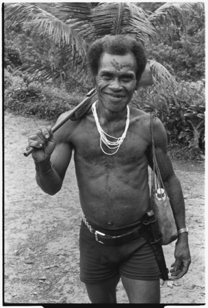 Biri 'Asu'ani with rifle.
