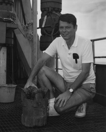 Co-Chief Scientist Ralph Moberly with a used drill bit on the catwalk aboard the D/V Glomar Challenger (ship) for the Deep...