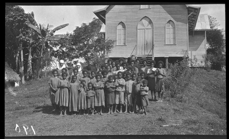 Children and missionaries in front of church at Dilava mission.