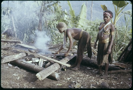 Food preparation: Ngatuomp and Mongor, Maring women, build a fire for cooking, Nemengemp