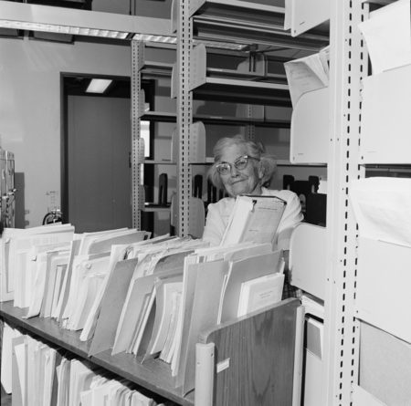 """Hubbs Library Move, 4-23-80"" [Image shows Laura Clark Hubbs (Mrs. Carl Leavitt Hubbs) in the Hubbs Library on April 23, 1..."