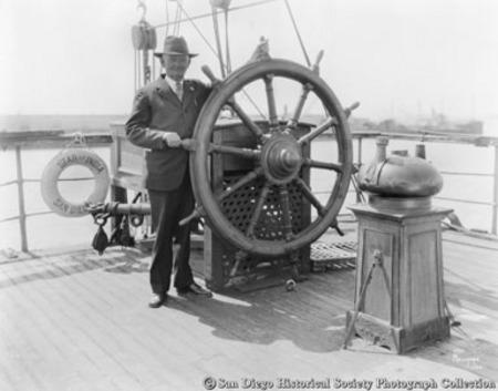Harbormaster Charles Stedman at wheel of sailing ship Star