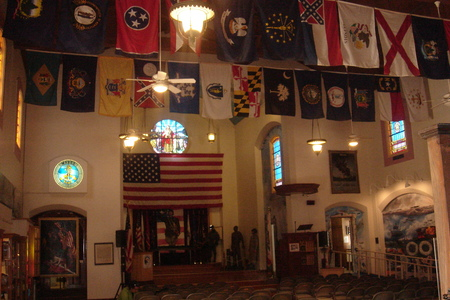 Heroes of War: Veterans Museum interior with flags