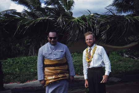 Prince of Tonga Tungi Tupou IV and scientist Alan Churchill Jones pose for a photo during the luau given to the scientist ...