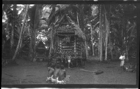 People around a yam house, Trobriand Islands.