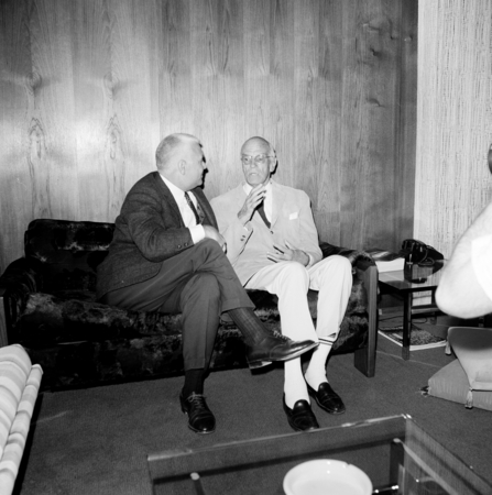 Seated are William J. (William James) McGill, Chancellor of UCSD from 1968 to 1970 (left), and philanthropist, Ernest W. M...