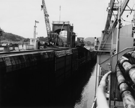 The D/V Glomar Challenger (ship) at right, passing through Panama Canal locks during the Deep Sea Drilling Project. 1979.