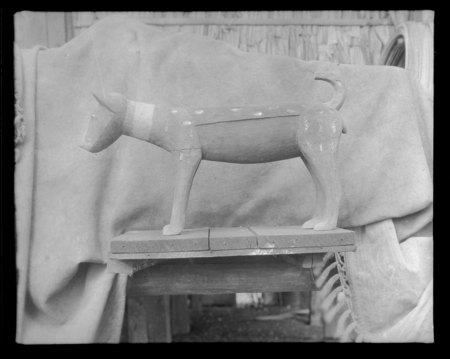 Carving of a wooden canine.
