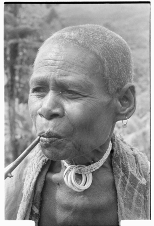 Older woman with tale'ekome necklace.