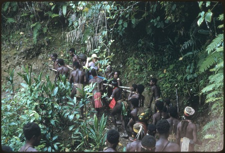 Nancy Cook is carried to Kompiai from Kabeng by group of men