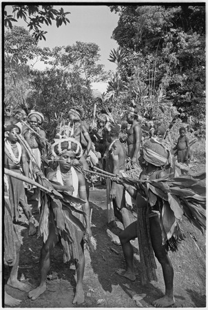 Pig festival, stake-planting, Tuguma: decorated Tsembaga men with ritual items to expel enemy spirits and establish boundary