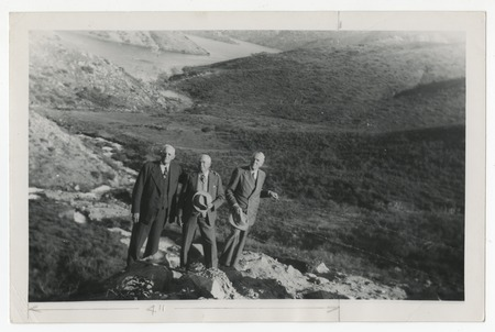 Ed Fletcher, Ed Hodge and G. Aubrey Davidson celebrating the first Colorado River water to reach San Vicente Lake, San Die...